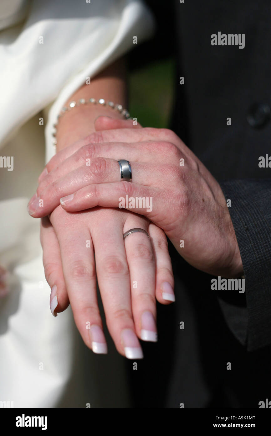 Bride and Groom show off wedding rings Stock Photo: 12384647 - Alamy