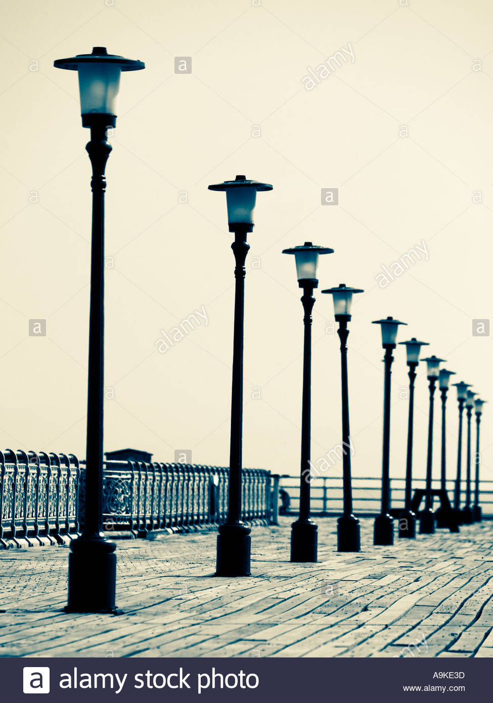 Row Of Lamp Posts On Mumbles Pier In Wales UK