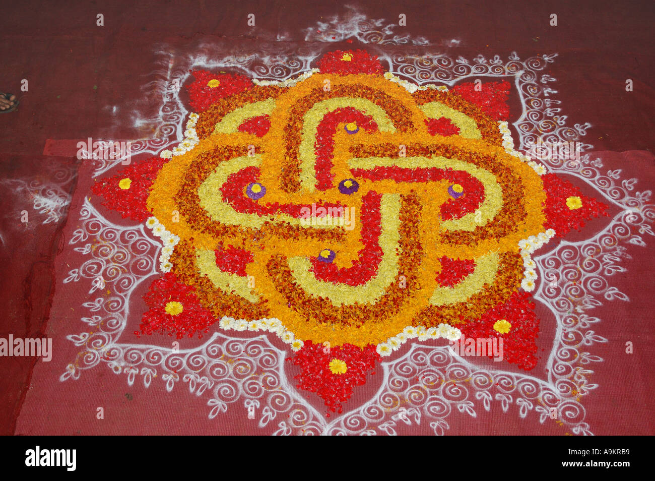 ANG99307 Indian Festival Auspicious Door Entrance Flower Decoration On Floor Called Rangoli During Diwali Onam Pongal India