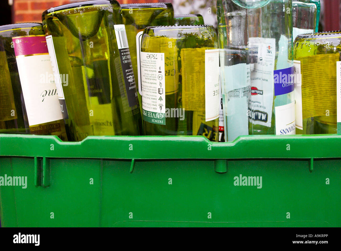 Empty wine bottles ready for collection and delivery to a bottle bank for recycling - Stock Image