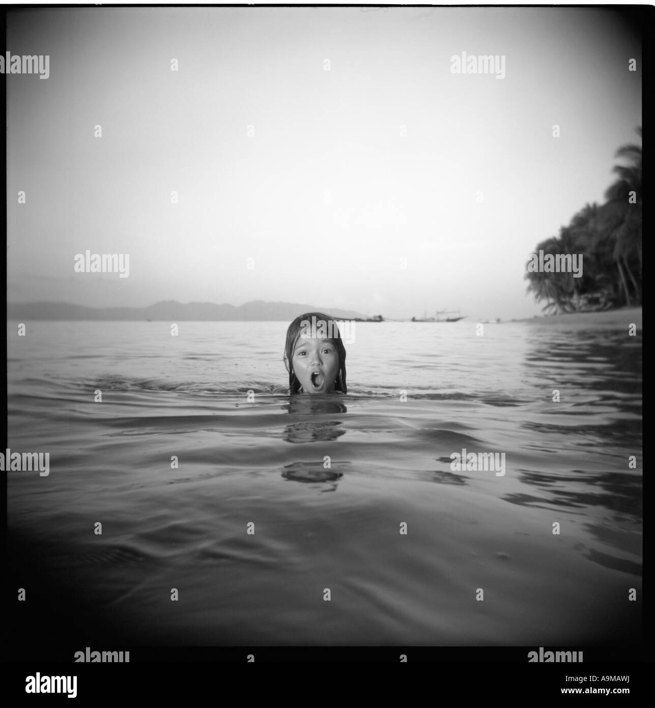 girl in the sea is screaming - Stock Image