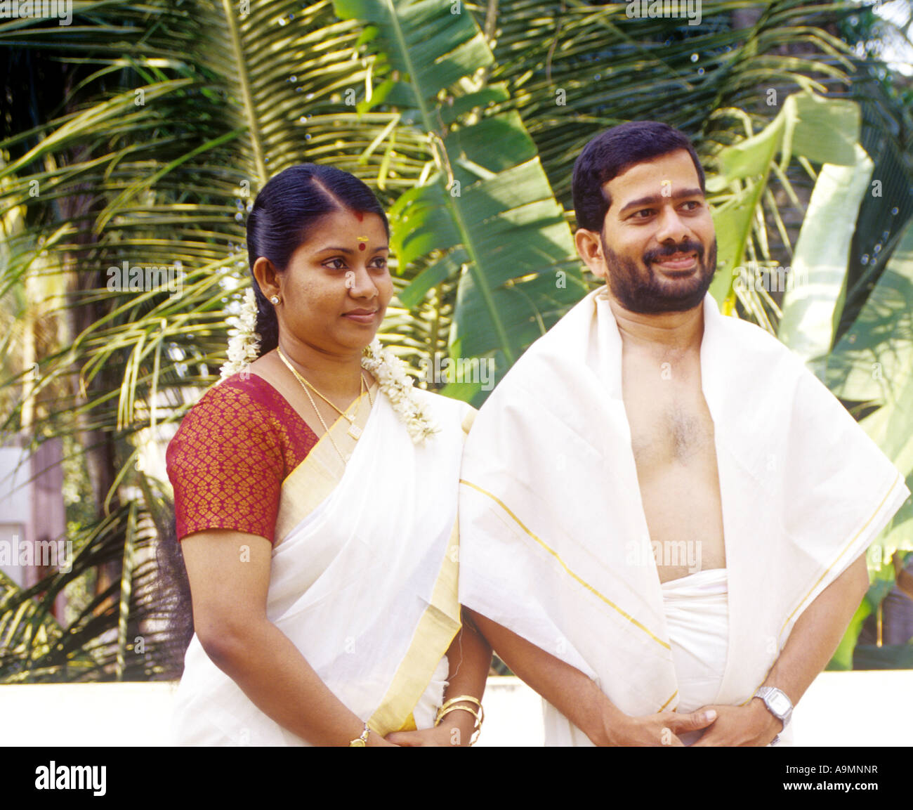 A COUPLE IN TRADITIONAL KERALA ATTIRE - Stock Image