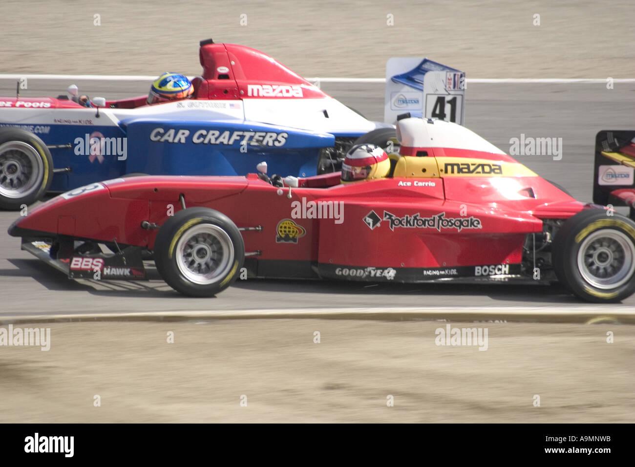 Star Mazda Race Cars on Track at Laguna Seca Adrian Carrio Driver ...