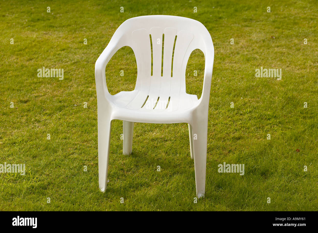 white plastic garden chair standing on lawn - Stock Image & Plastic Garden Chair Stock Photos u0026 Plastic Garden Chair Stock ...