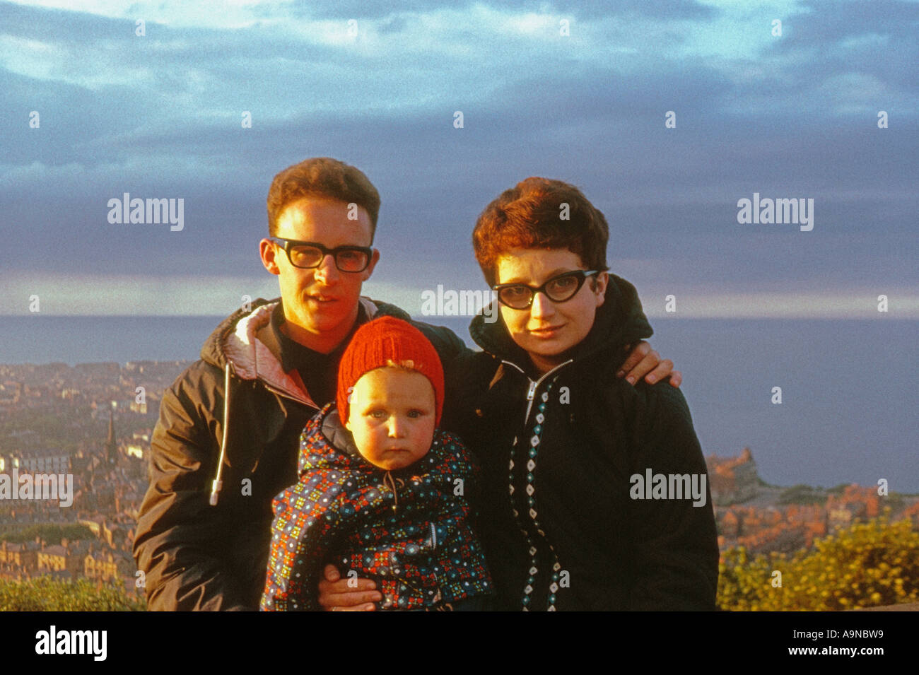 young family at seaside in 1960 s - Stock Image
