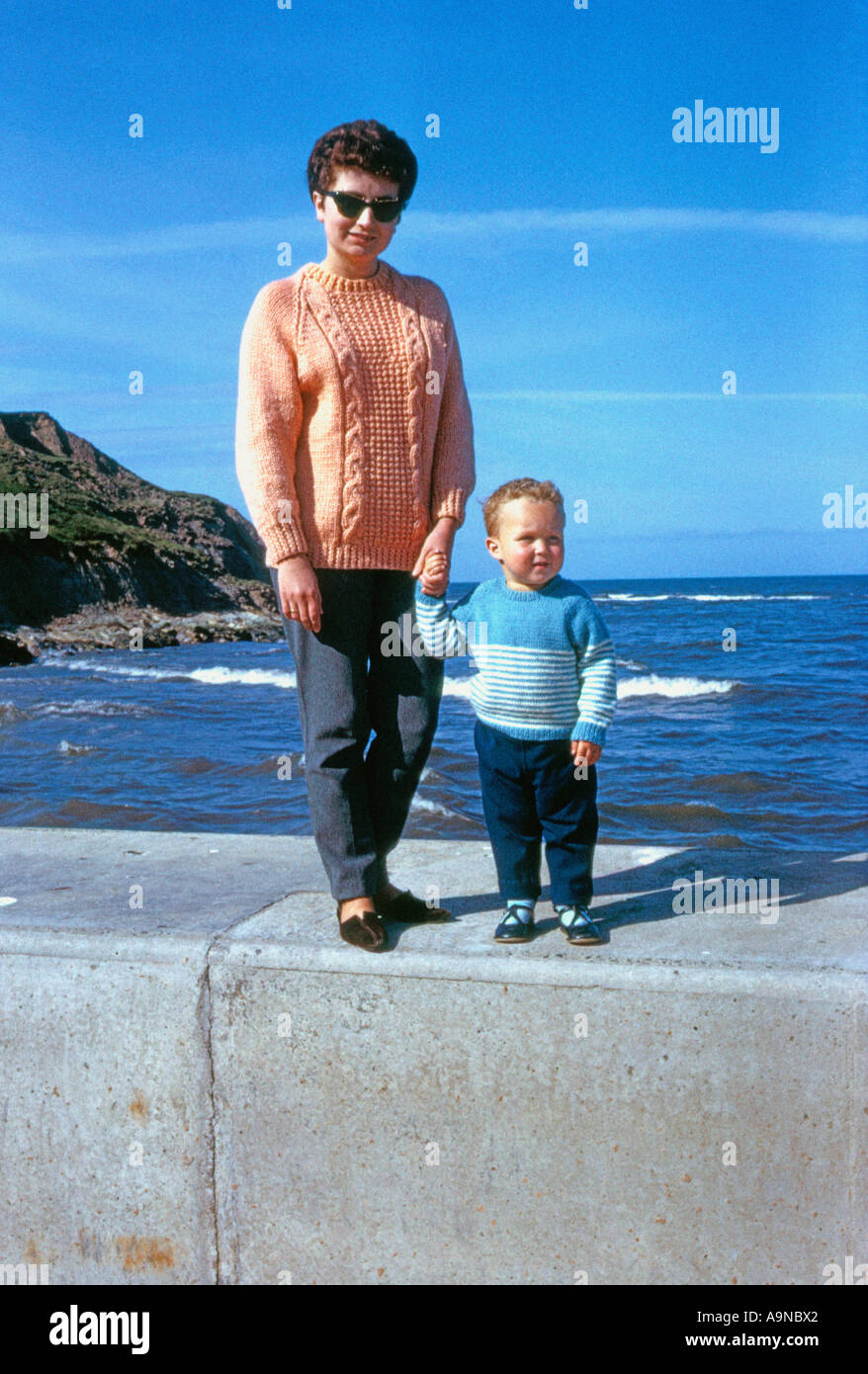 young mother with son at seaside during 1960 s - Stock Image