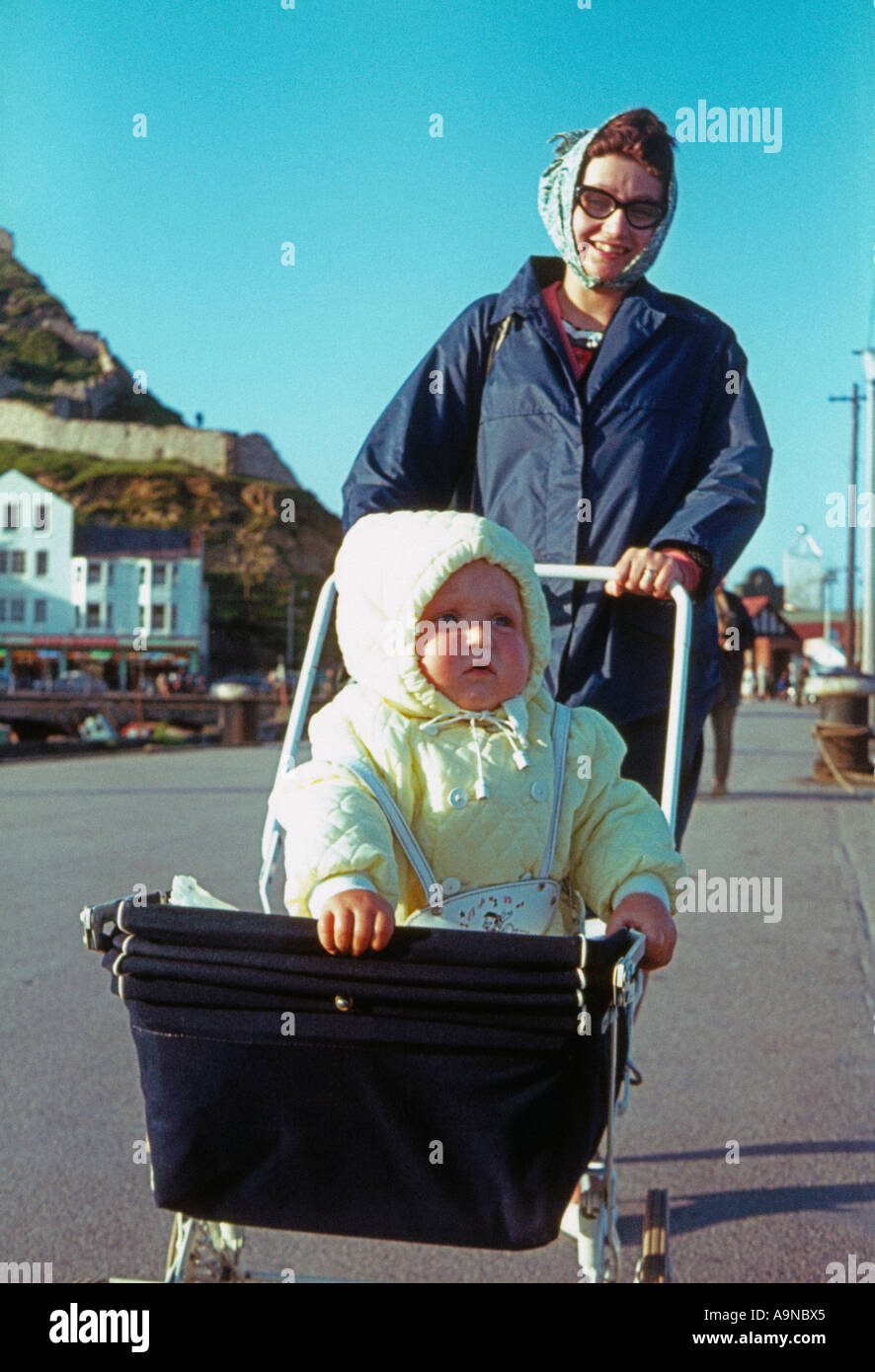 young mother baby at seaside during 1960 s - Stock Image