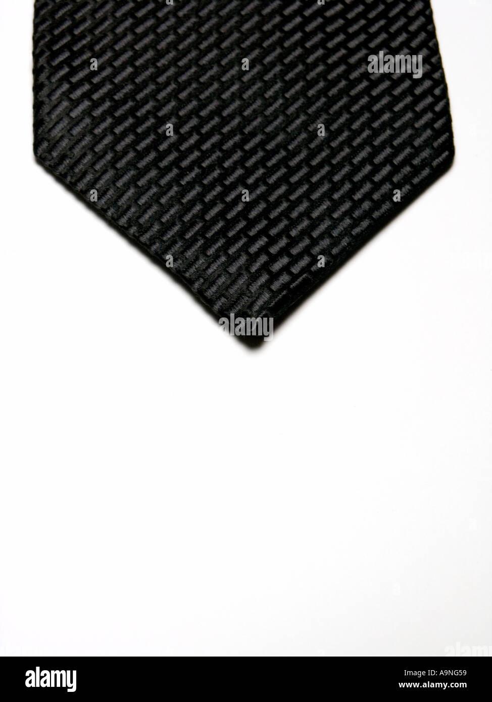 BLACK TIE ON WHITE BACKGROUND - Stock Image