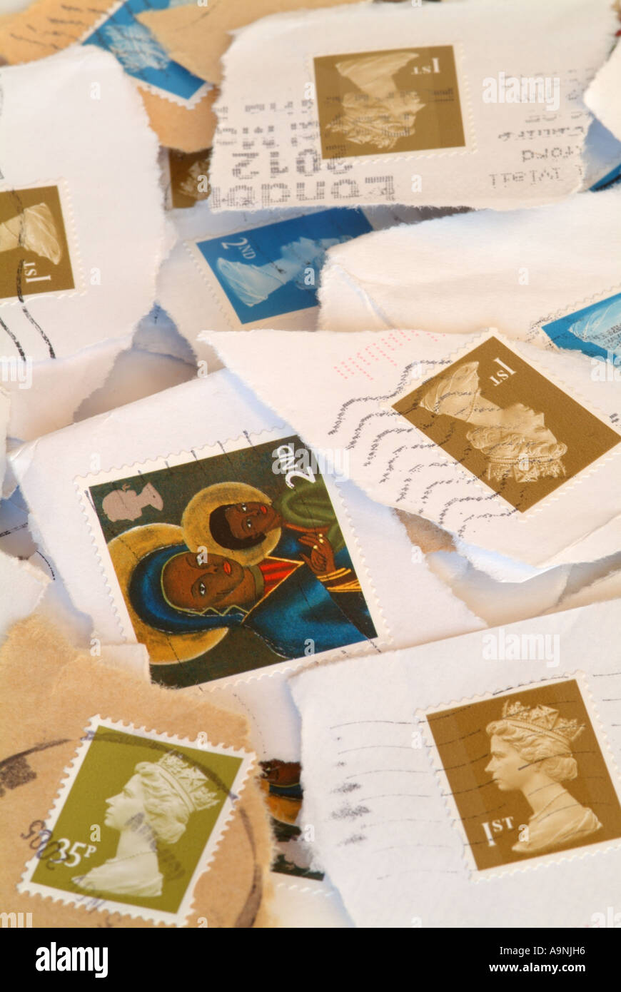 A pile of UK stamps for recycling. - Stock Image