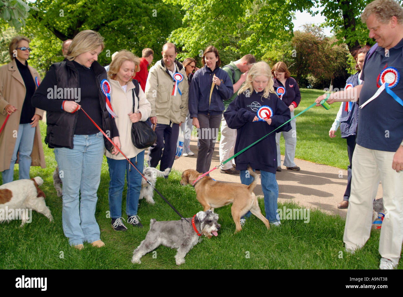 DOG OWNERS IN REGENTS PARK FOR CHARITY EVENTS  LONDON - Stock Image