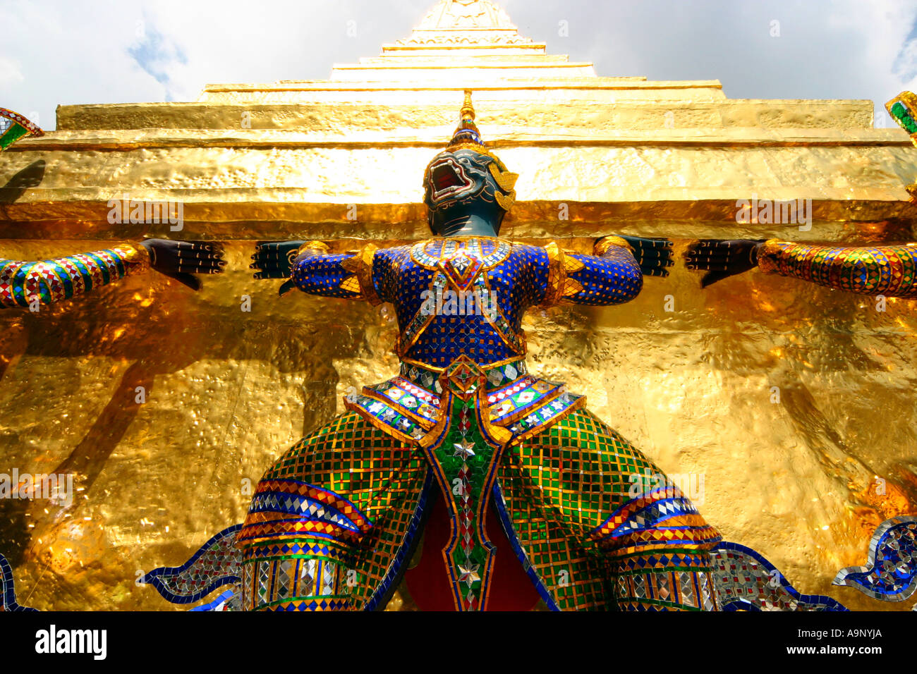 Warrior on golden chedi at Wat Phra Kaew Bangkok Thailand - Stock Image
