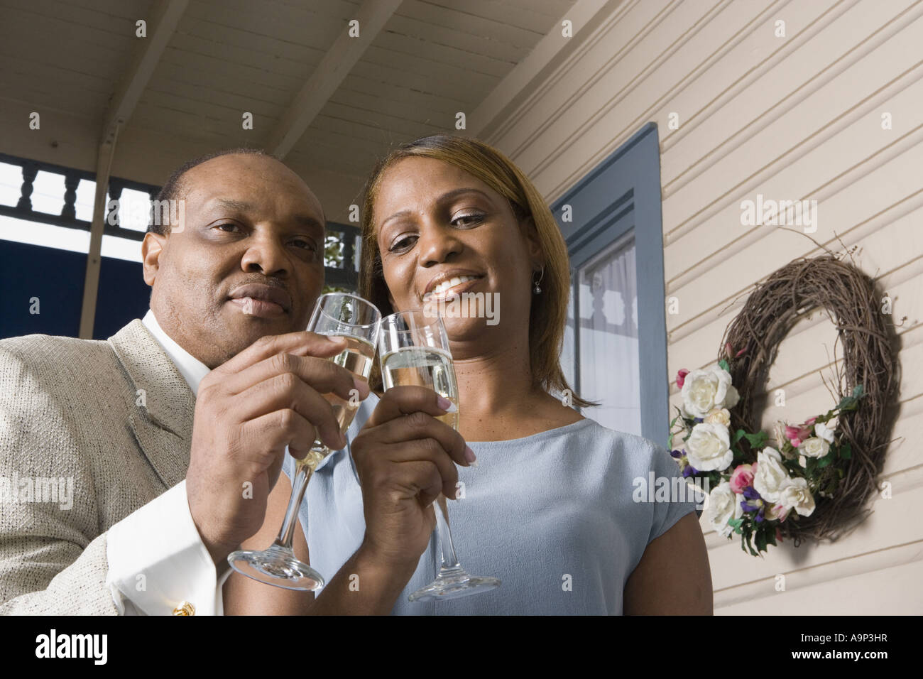 Portrait of a mature couple toasting with champagne - Stock Image
