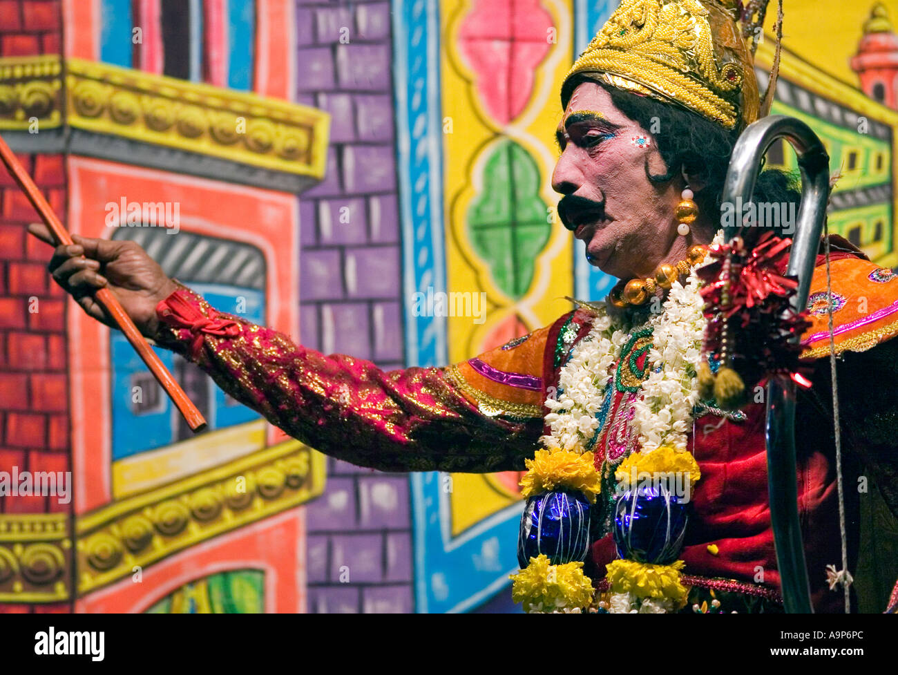 Indian street actor dressed as Arjuna performing The Mahabharata on stage - Stock Image