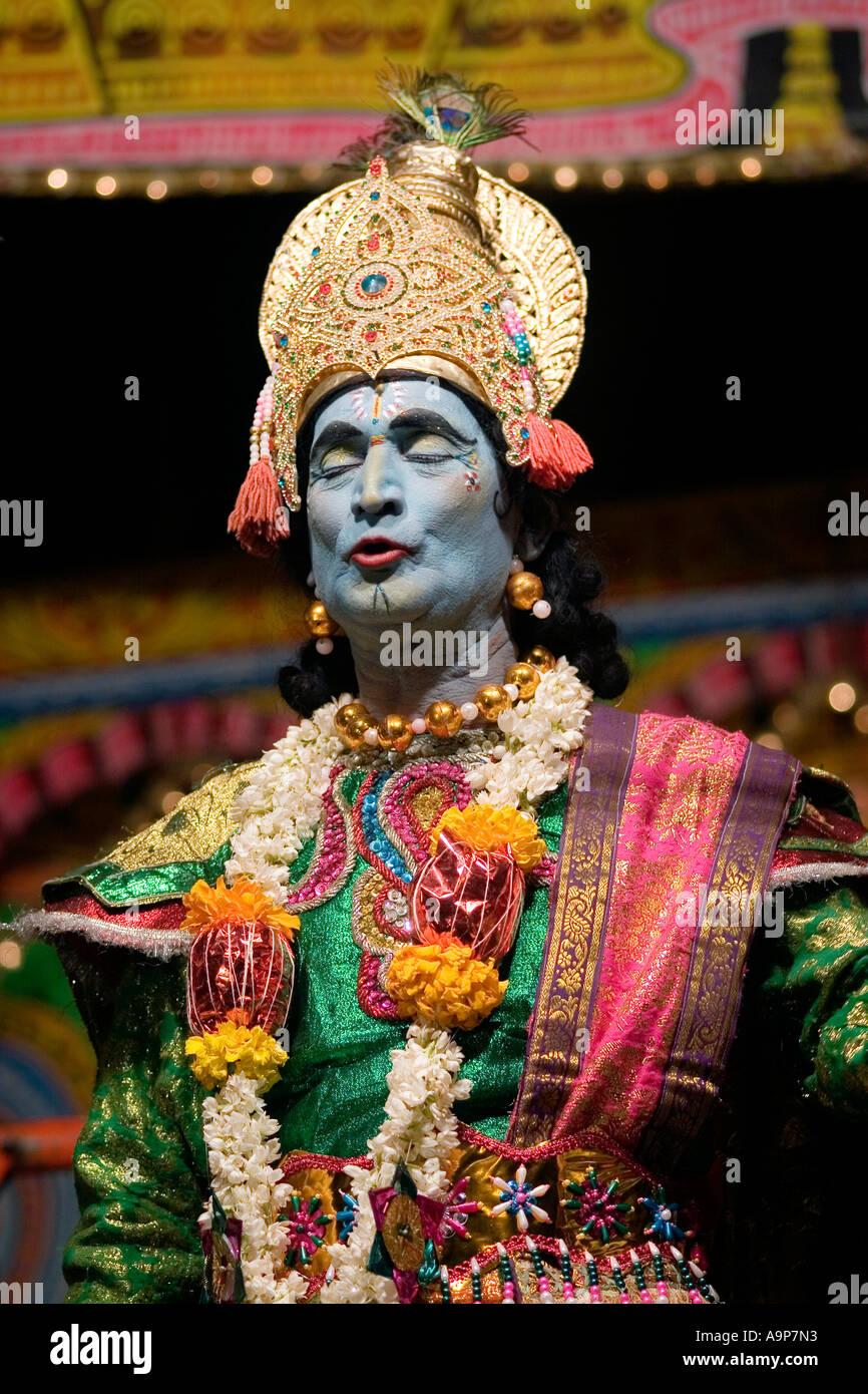 Indian actor dressed as Krishna performs street theatre mahabharata play - Stock Image