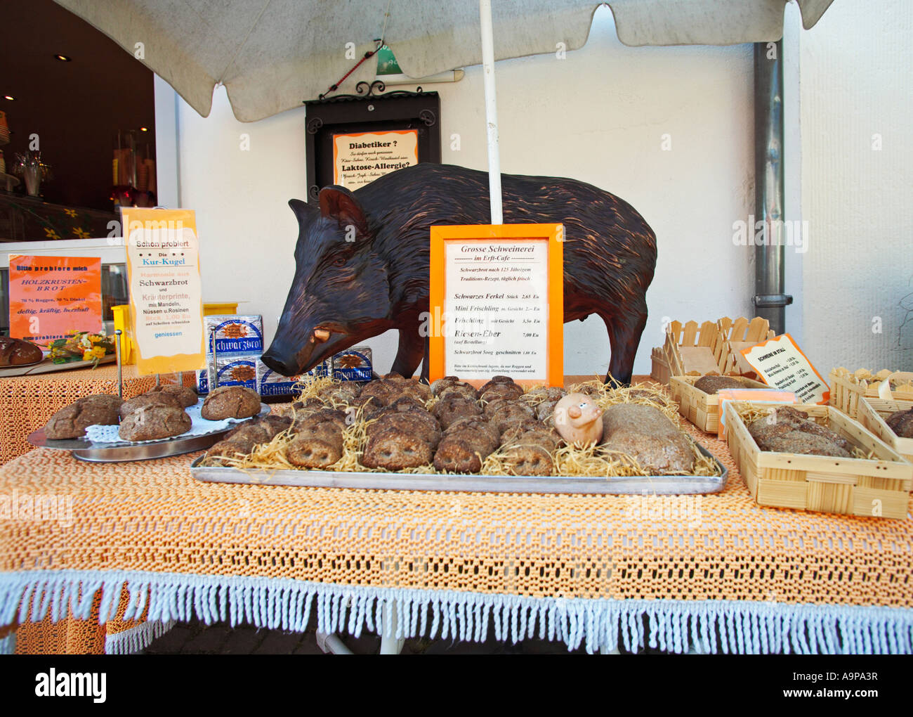 German rye breads on table outside store in Bad Munstereifel, Rhineland, Germany Europe - Stock Image