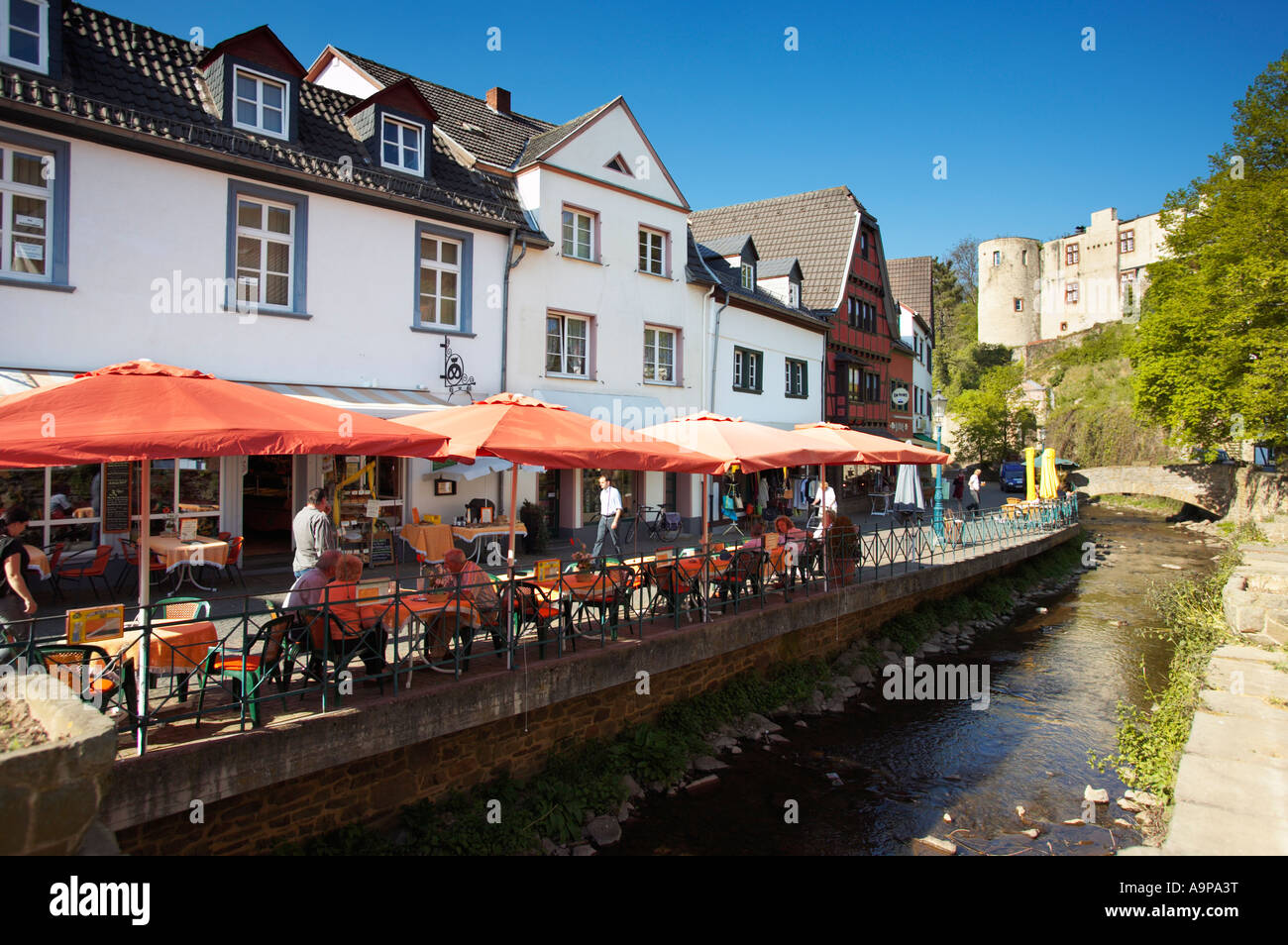 Pavement cafes by the Erft in historic Bad Munstereifel, Rhineland, Germany, Europe - Stock Image