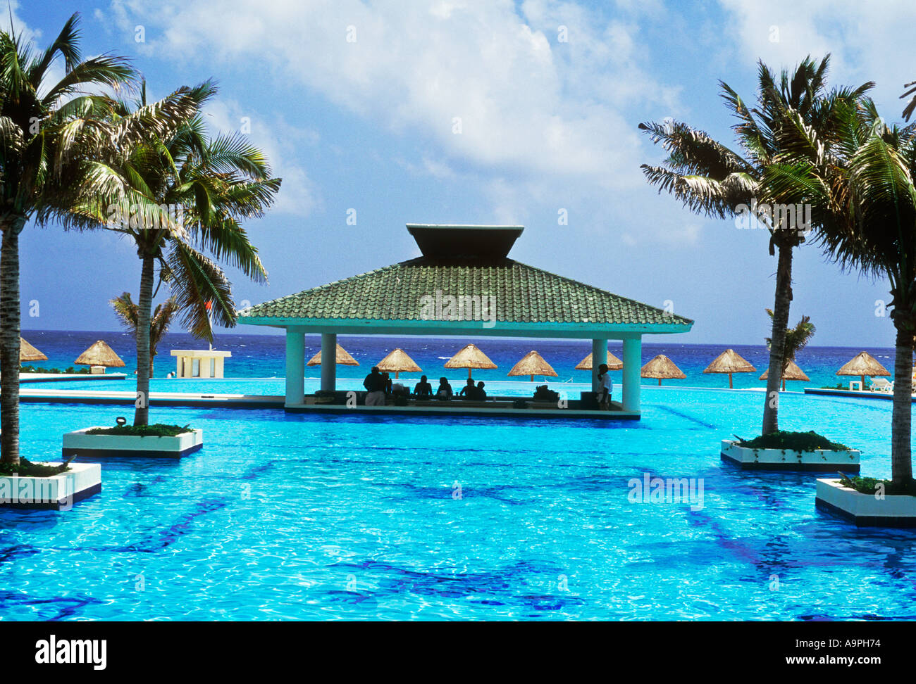 Mexico Cancun Pool And Swim Up Bar With Palapas On Beach Stock Photo 4053363 Alamy