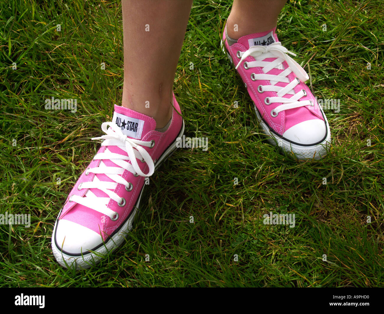 dffef0f89007b4 Girl s feet wearing new pair of pink All Star trainer shoes Stock ...