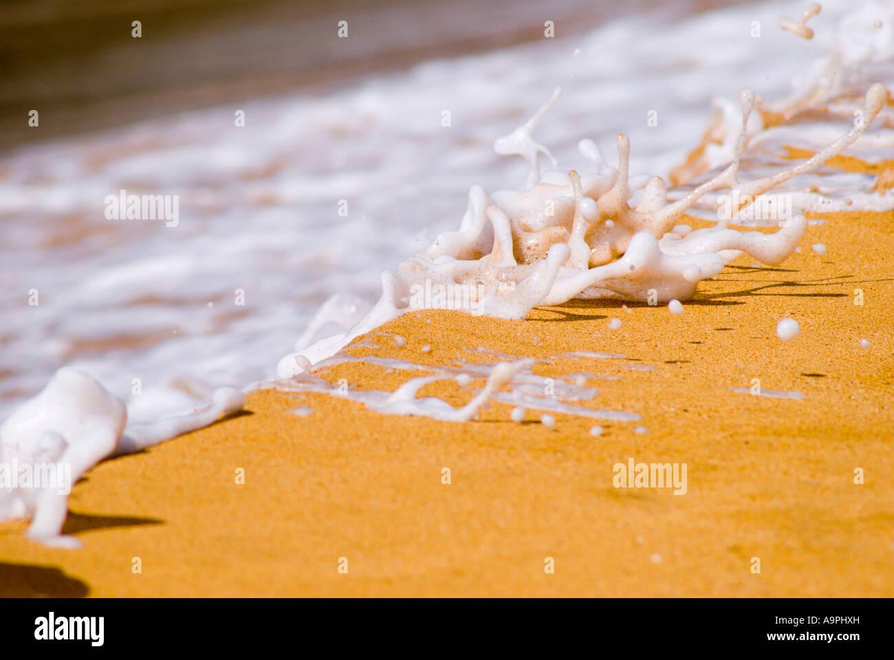 Surf detail at Secret Beach on the North Shore Island of Kauai Hawaii Stock Photo