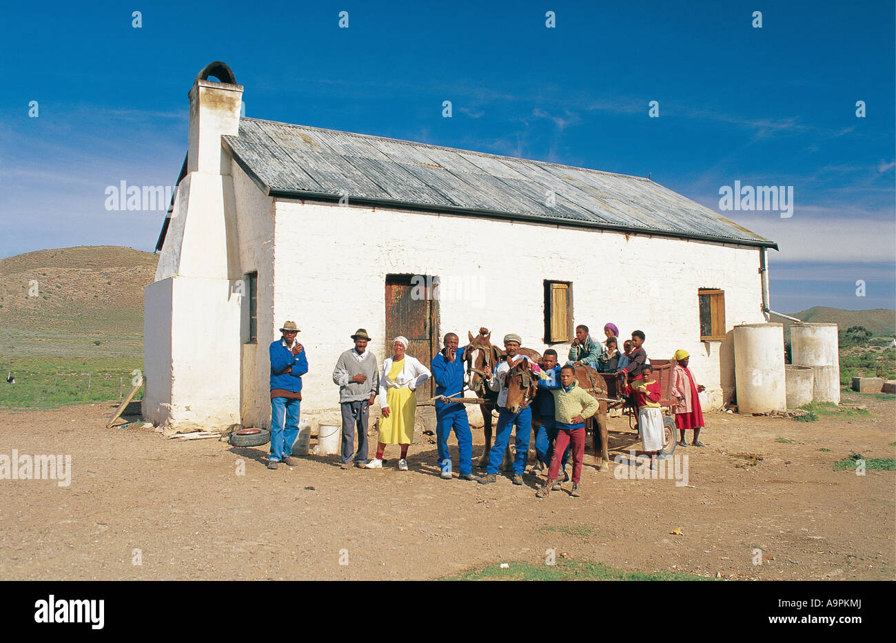 Family gathered outside their cottage Little Karoo Western Cape South Africa - Stock Image