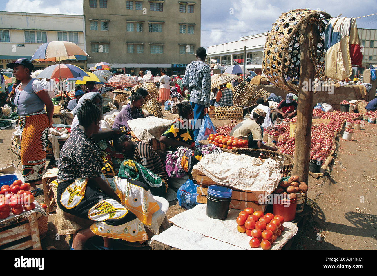 Market scene Arusha Tanzania East Africa The women have turned their heads to avoid being photographed - Stock Image