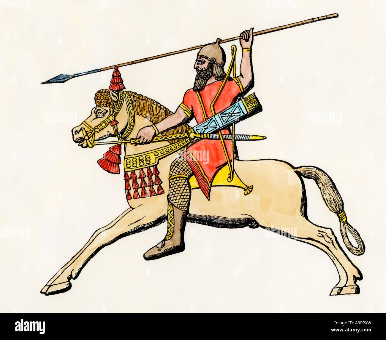 Babylonian warrior on horseback. Hand-colored woodcut - Stock Image
