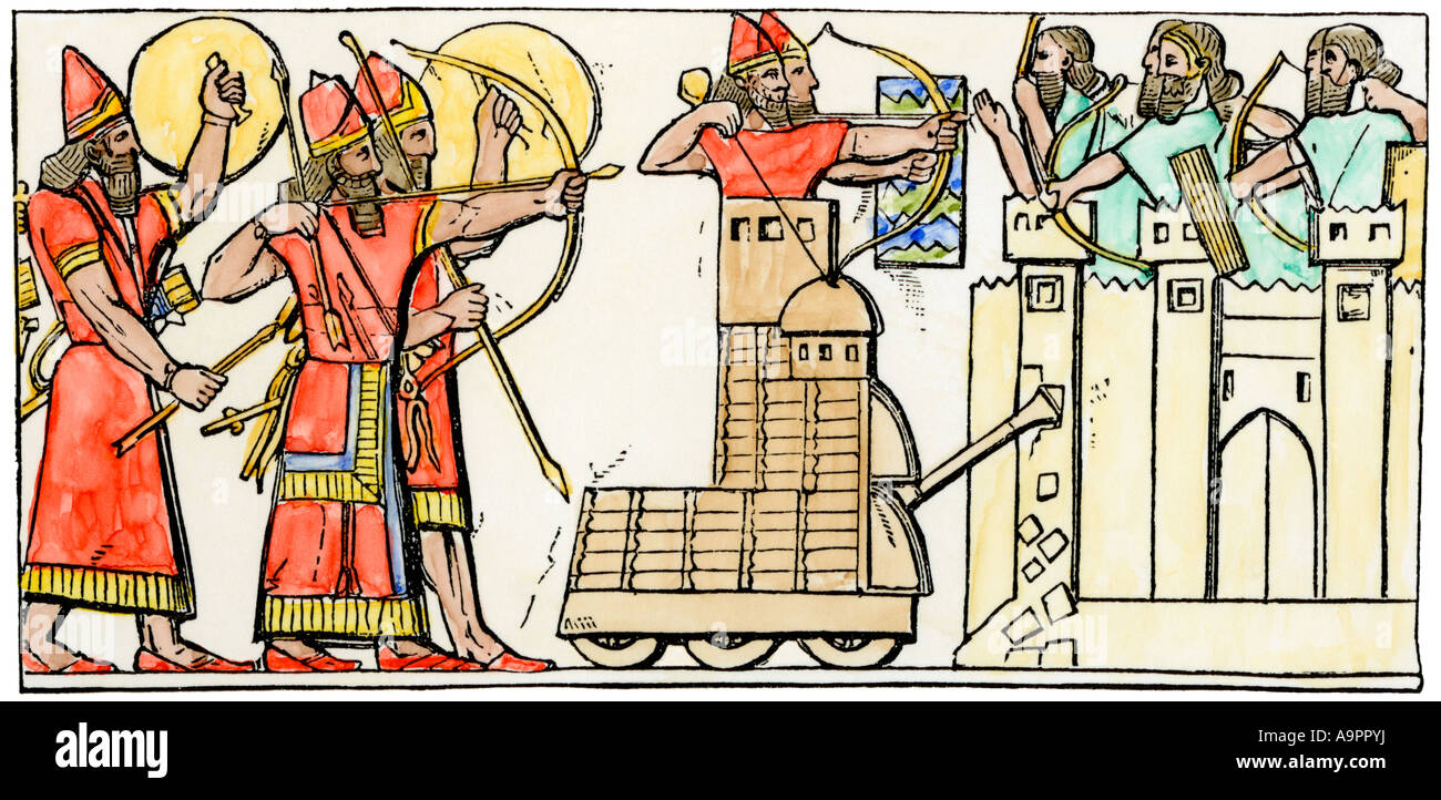 Assyrian siege of a city showing use of a battering ram. Hand-colored woodcut - Stock Image