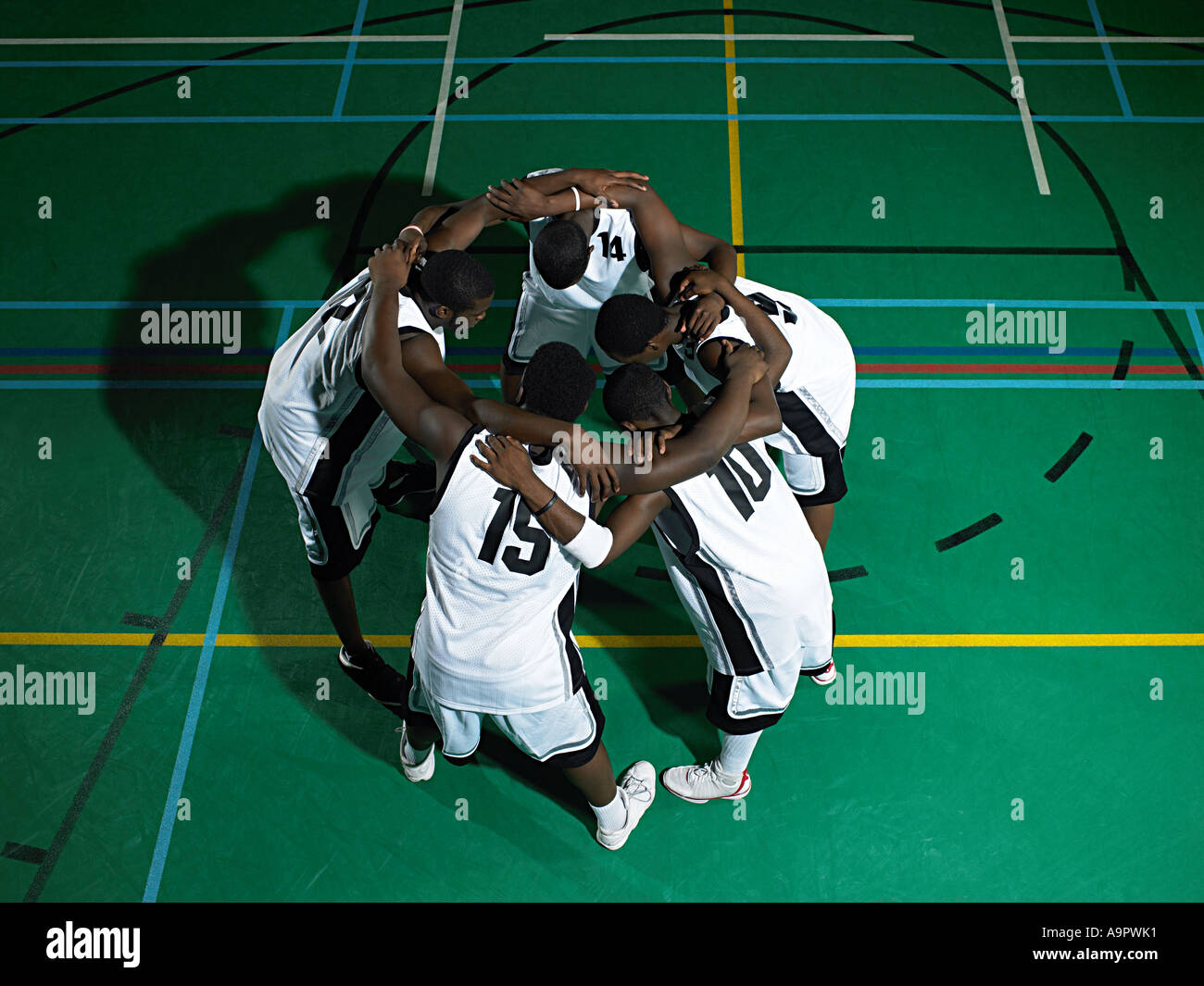 Basketball players huddling - Stock Image