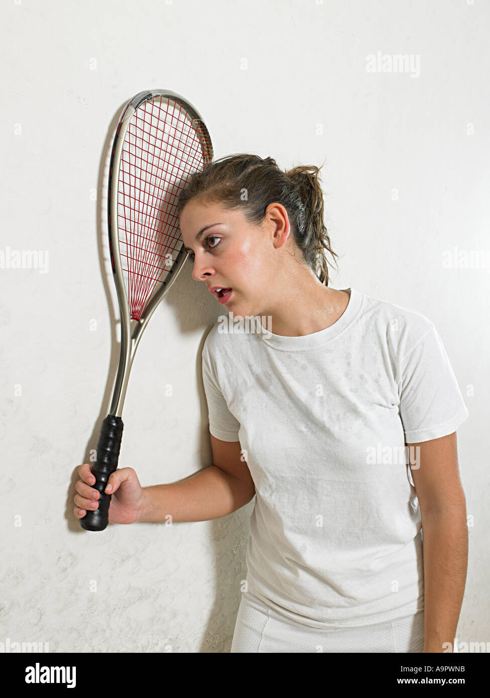 Exhausted squash player - Stock Image