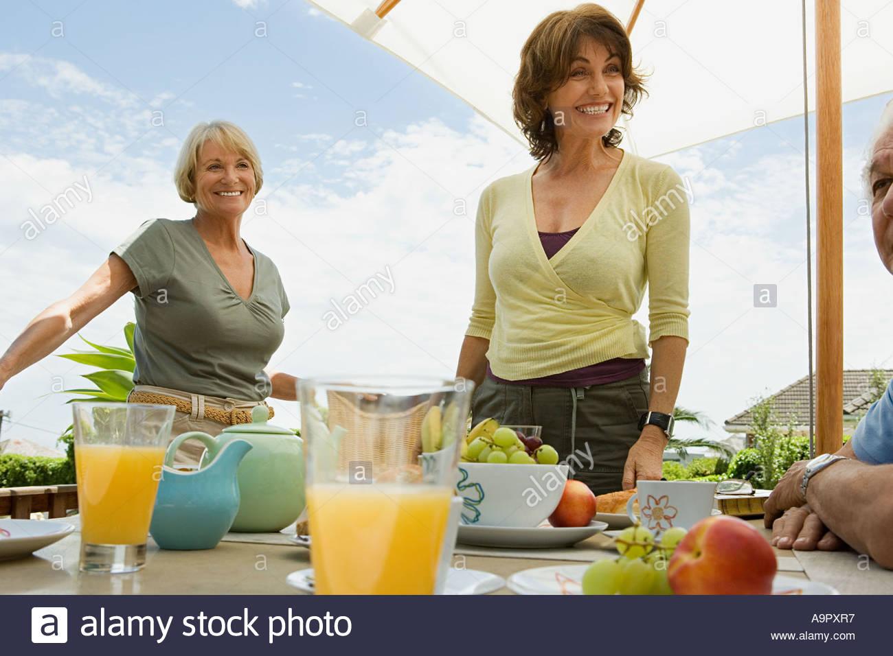 Senior adults serving breakfast - Stock Image