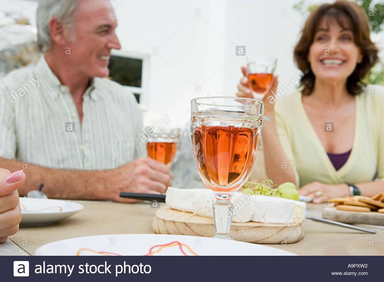 Senior adults drinking wine - Stock Image