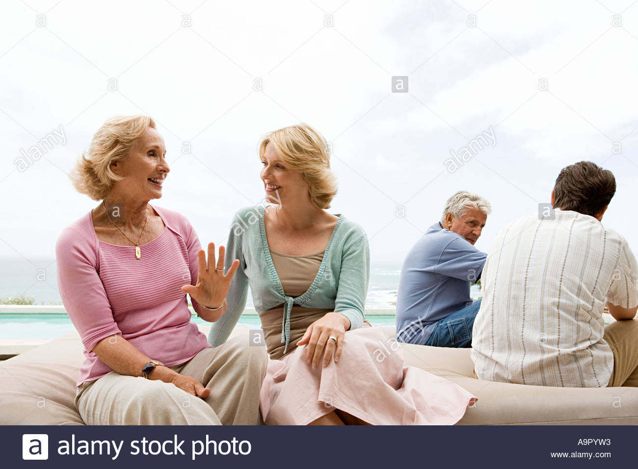 Portrait of four family members - Stock Image