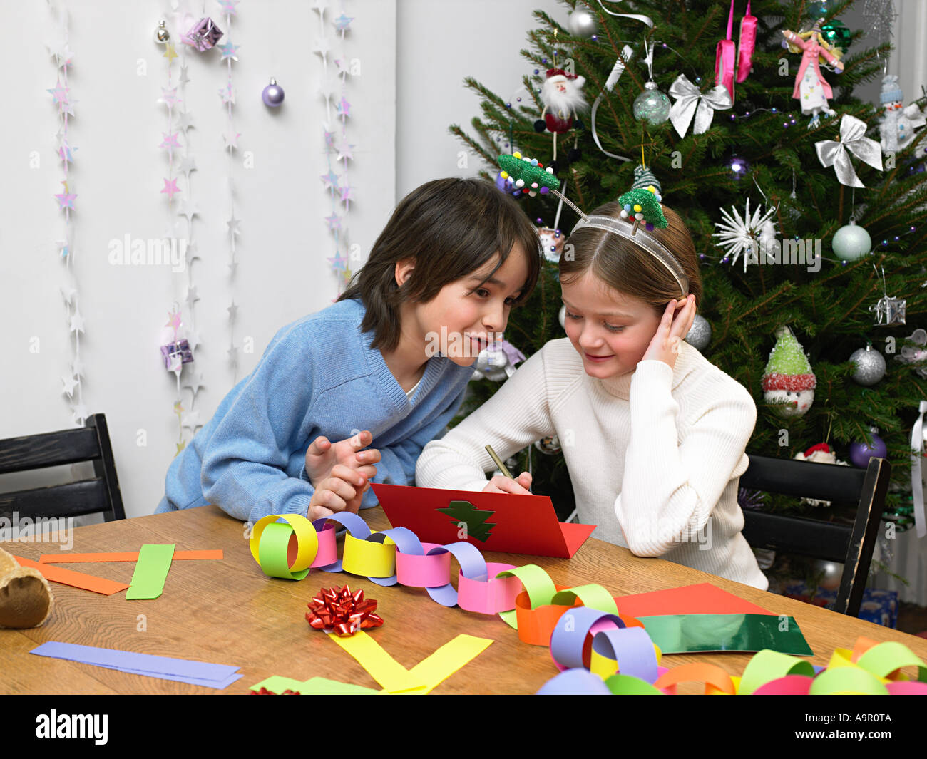 children making christmas cards and decorations stock image