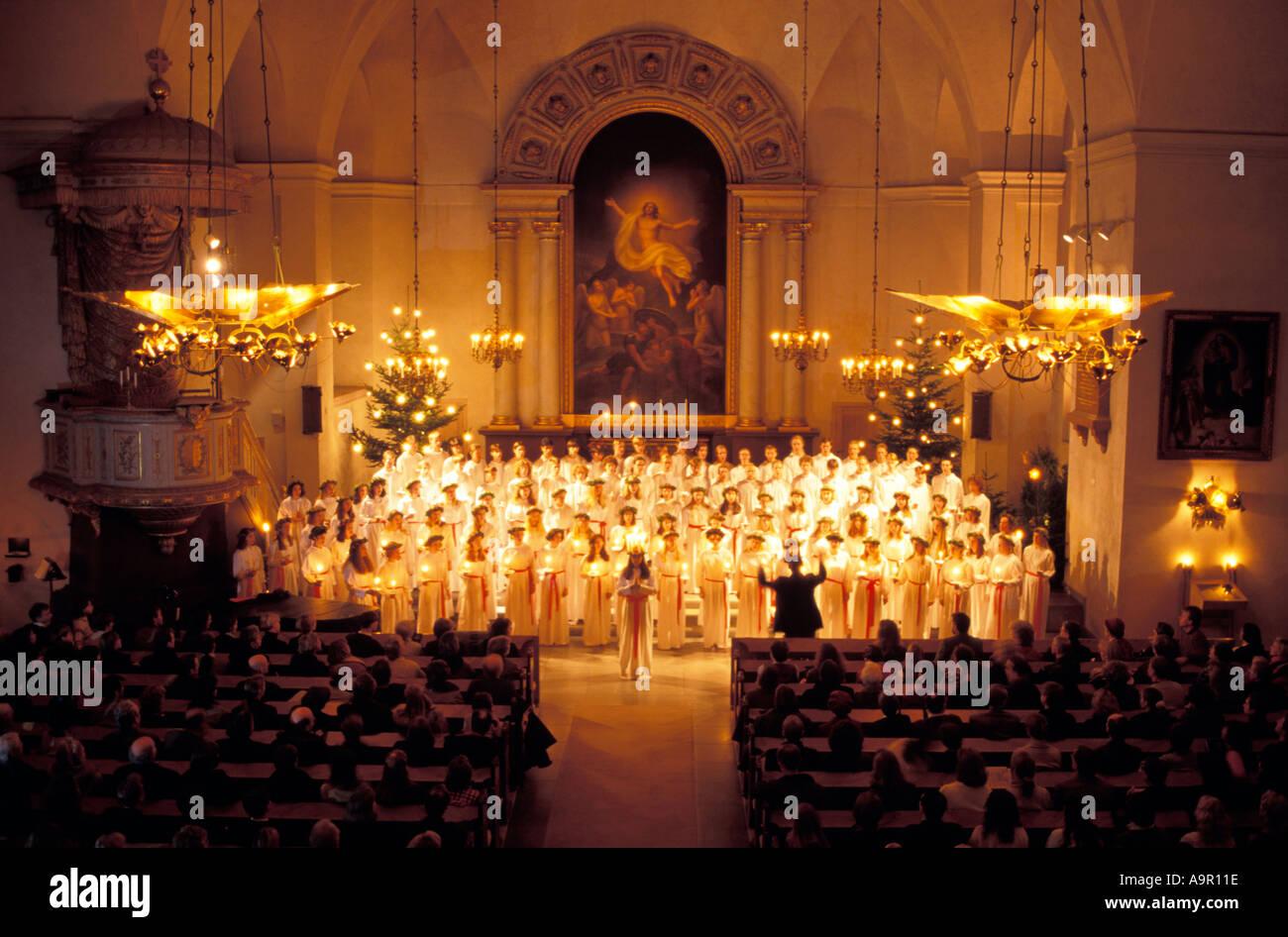 Children's choir at Kungsholmen Church in Stockholm on Santa Lucia Day December 13 - Stock Image