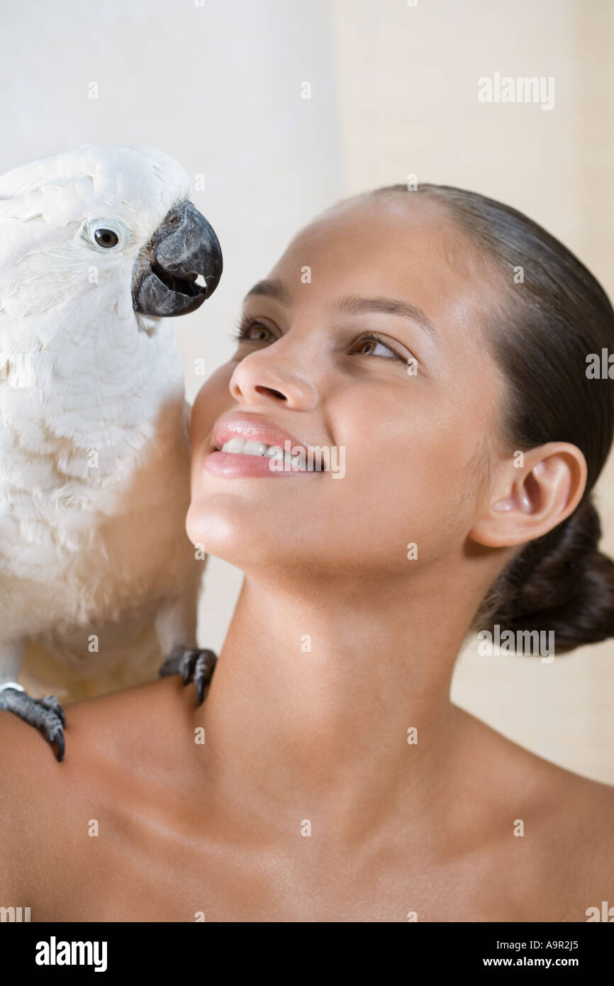 Girl with cockatoo on her shoulder - Stock Image