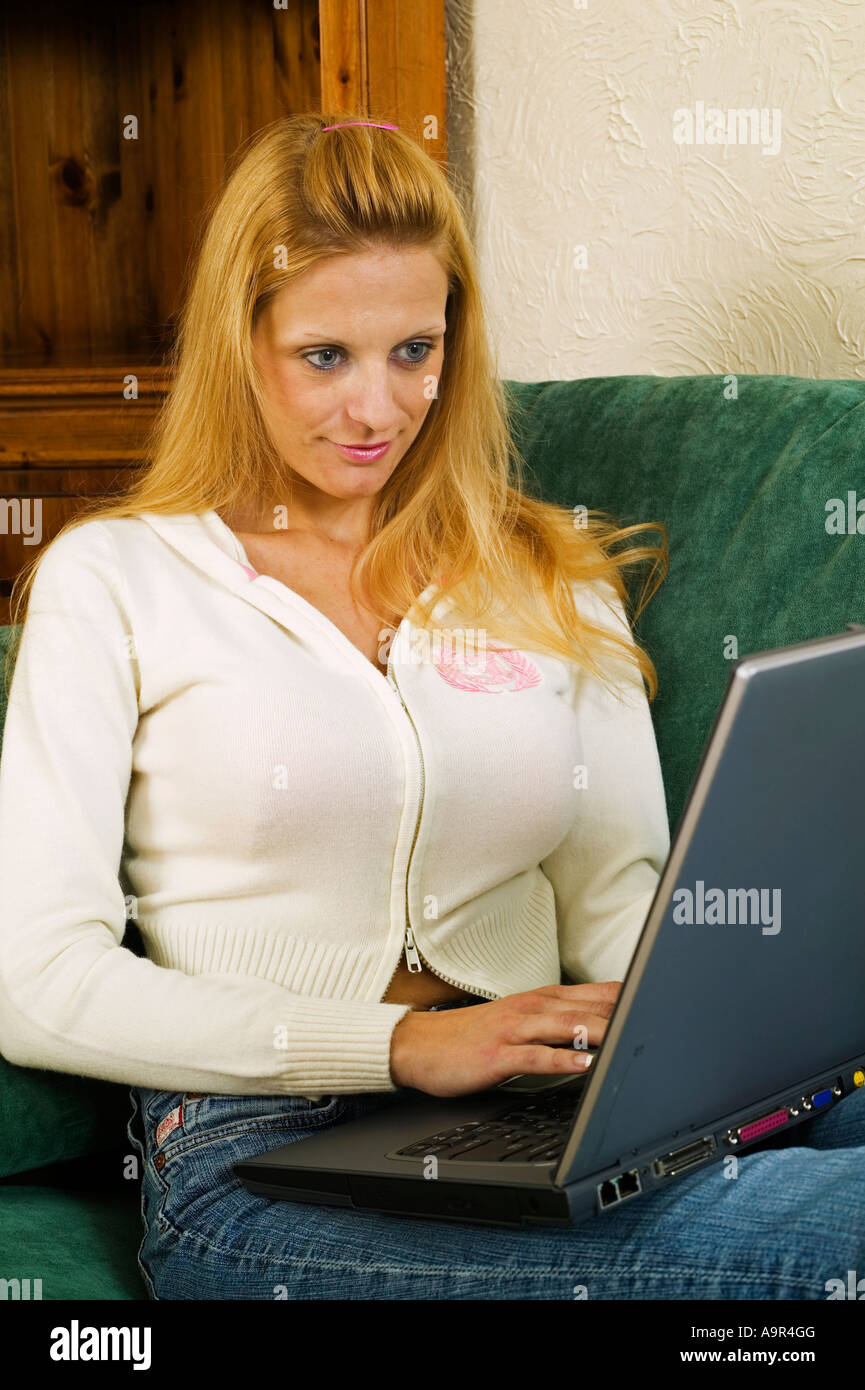 Woman browsing at home with a laptop computer Stock Photo