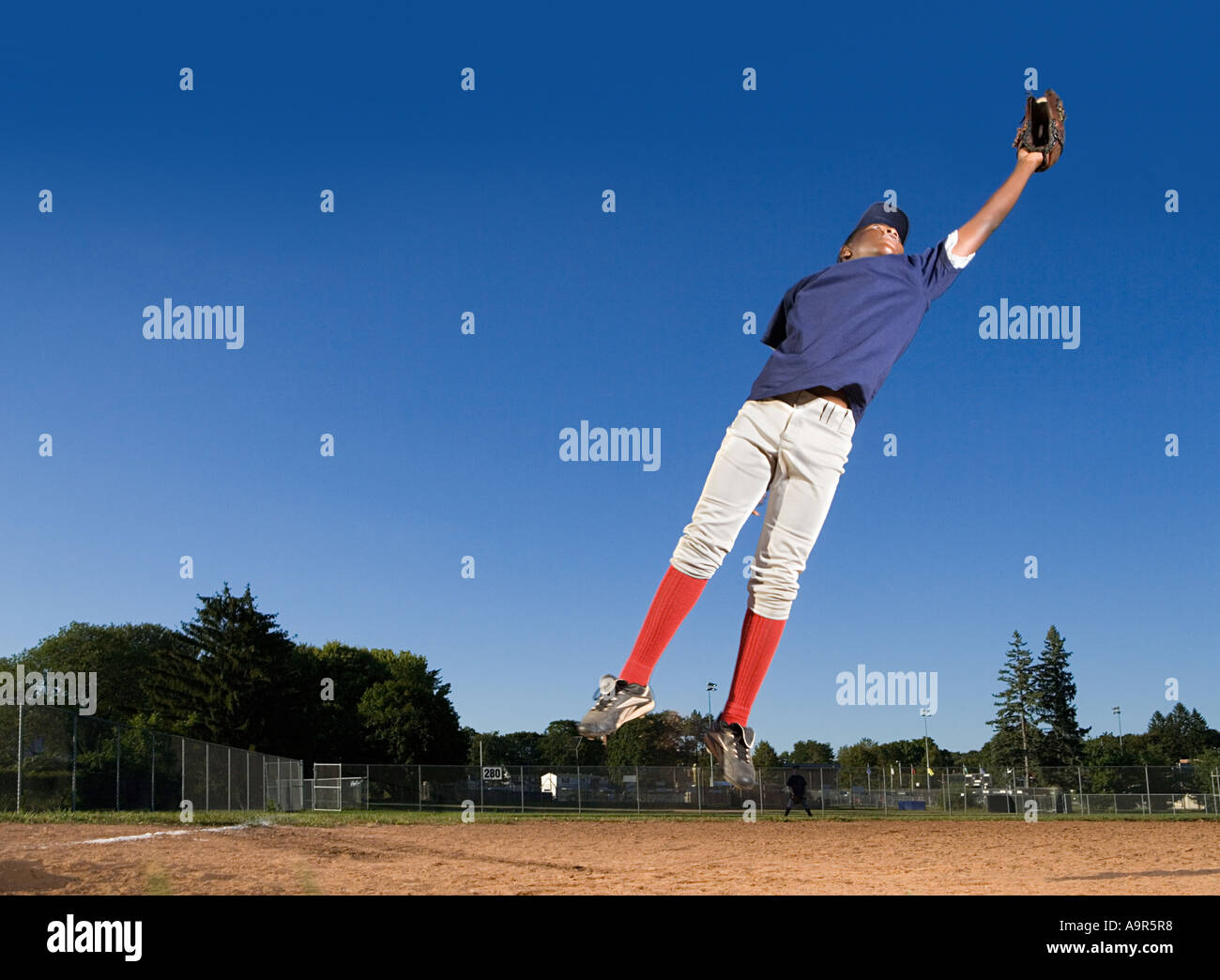 Teenage boy playing baseball - Stock Image