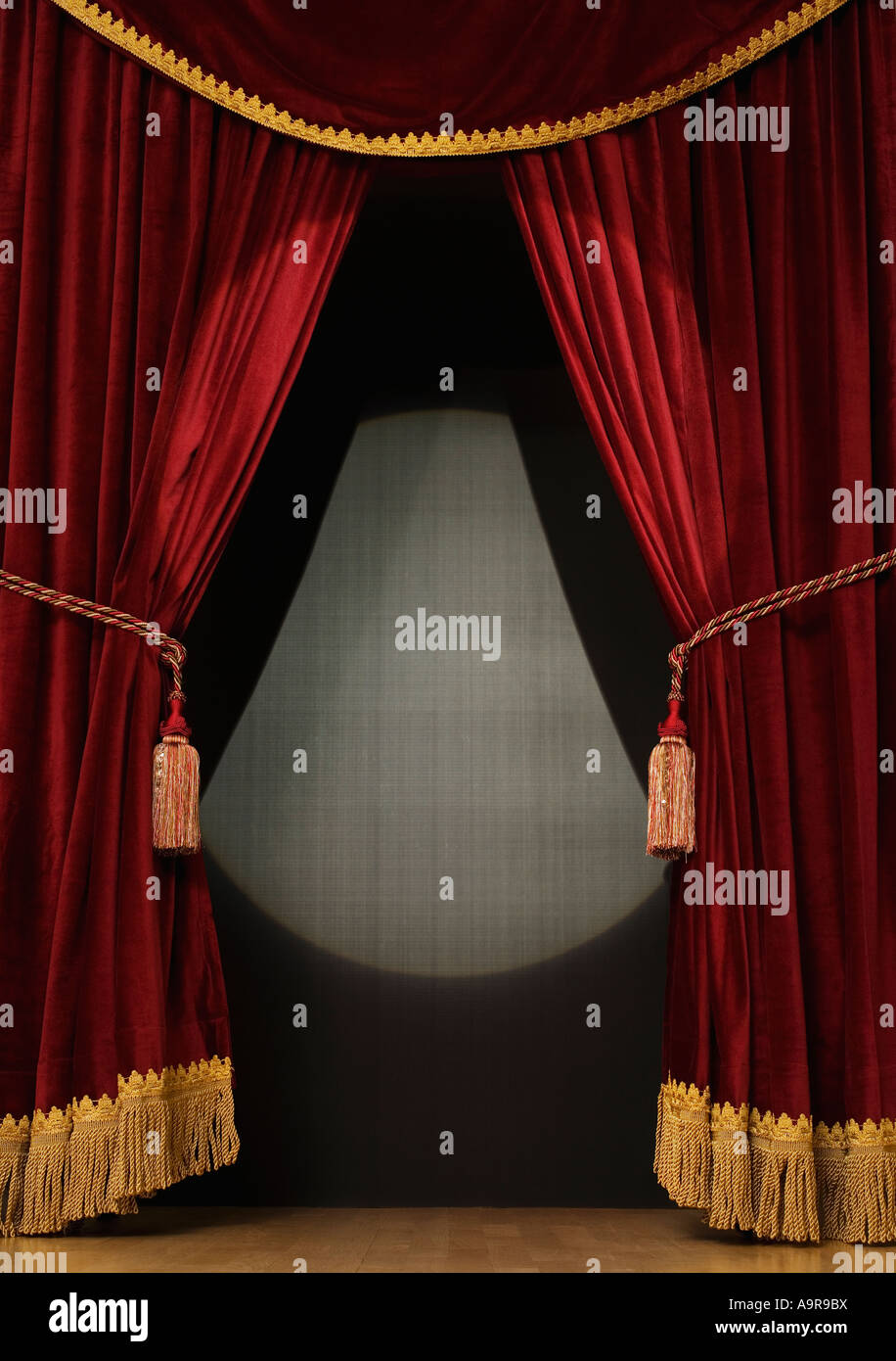 Spotlight on open stage curtains - Stock Image