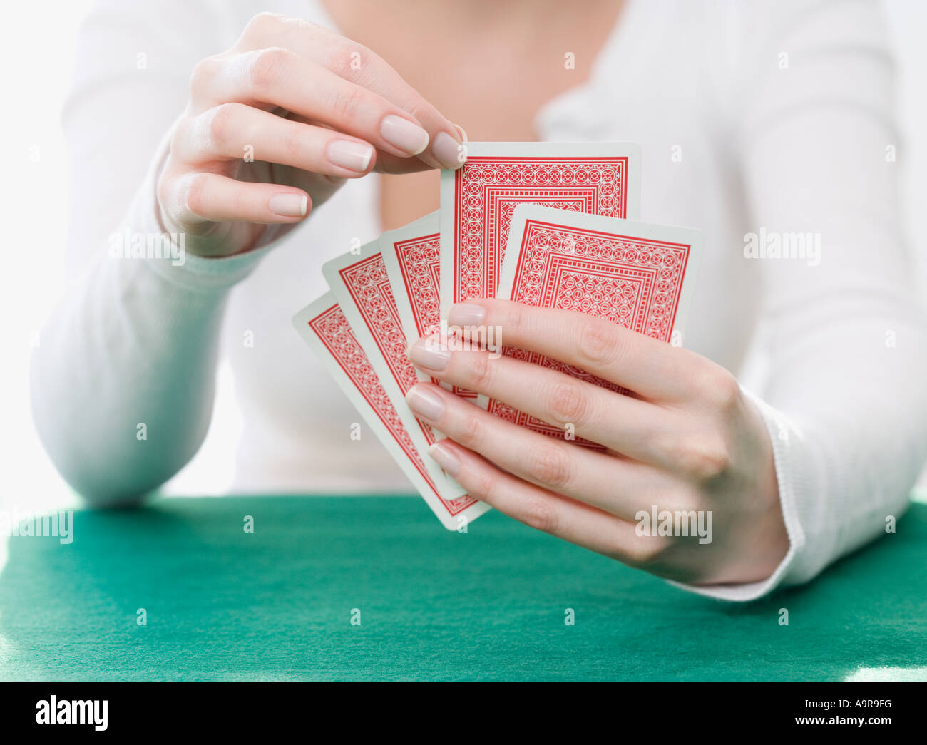 Woman playing cards - Stock Image