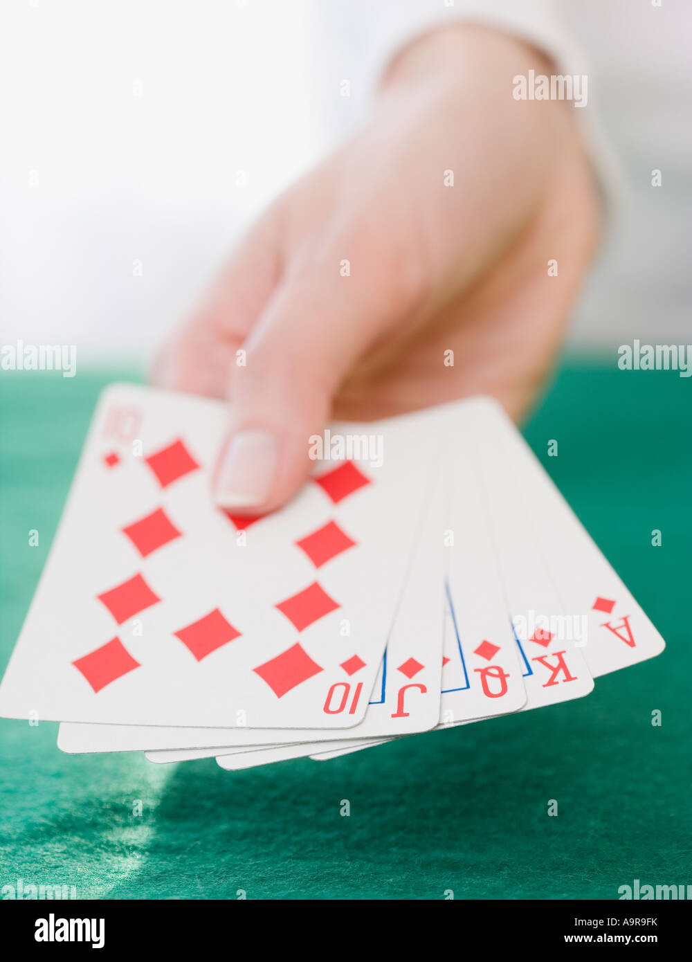 Woman holding straight flush playing cards - Stock Image