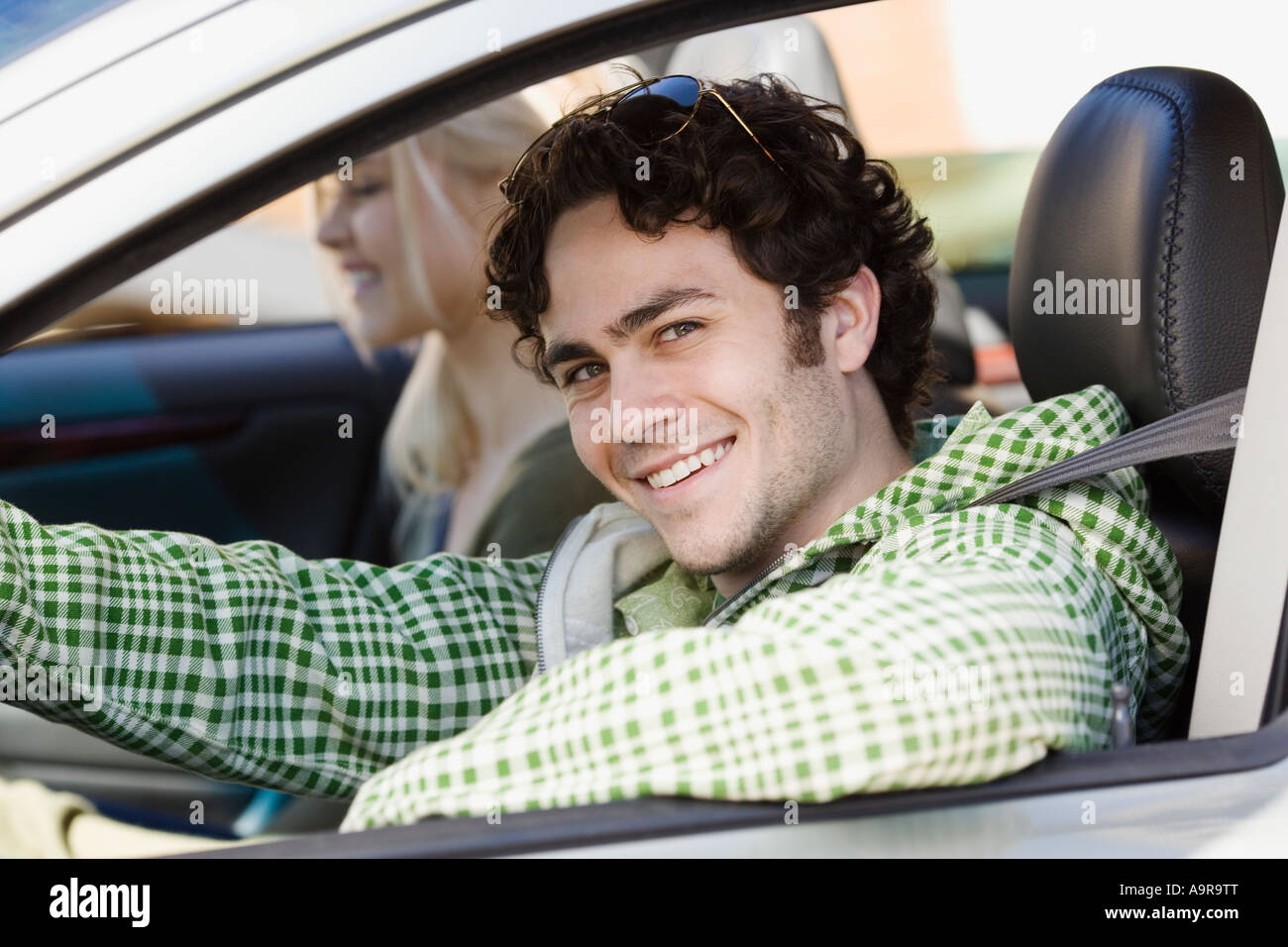 Man sitting in driver s side of car - Stock Image