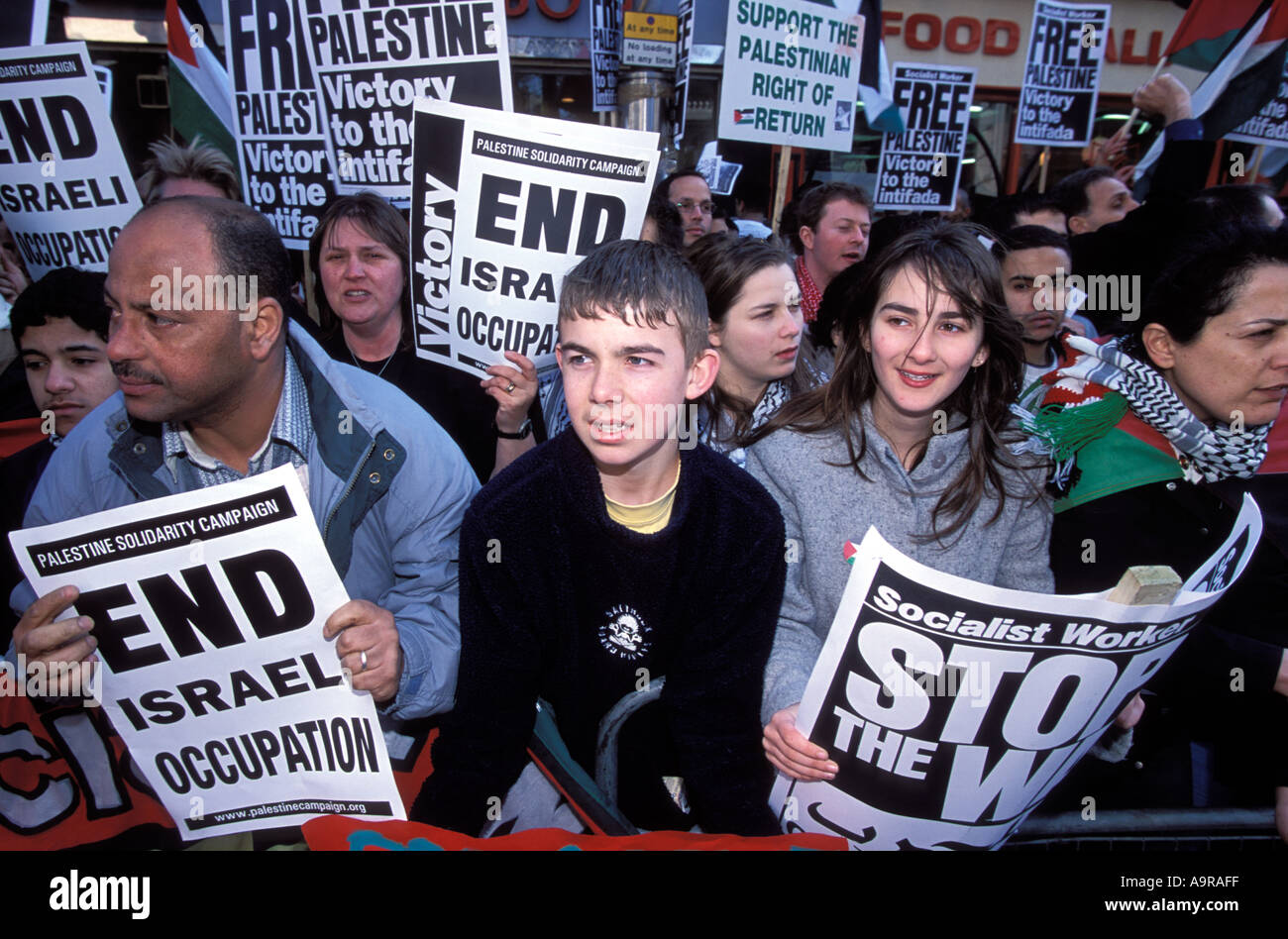 People demonstrating against the Israeli occupation of Palestinian territory London UK - Stock Image