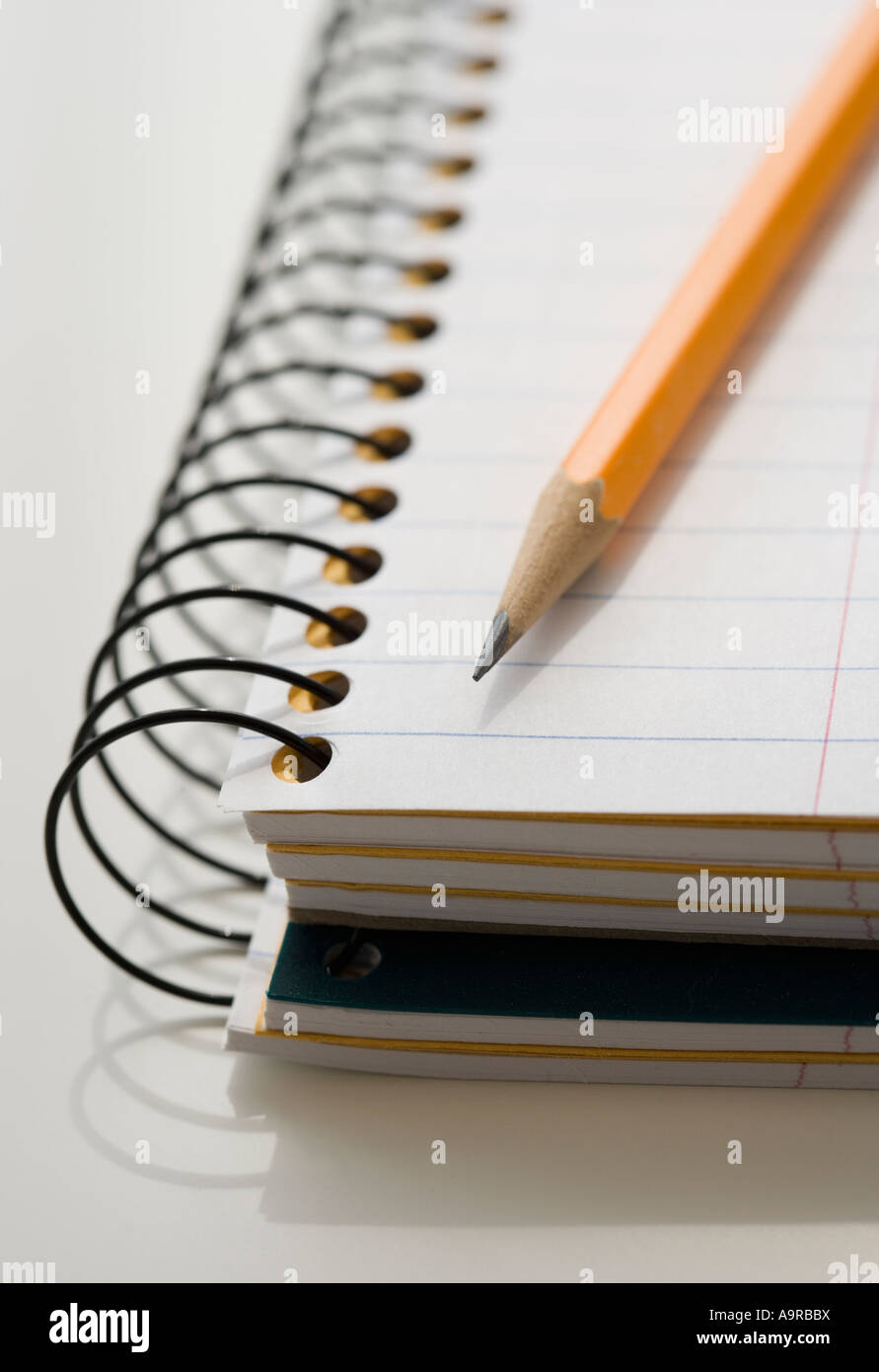 Close up of notepad and pencil - Stock Image
