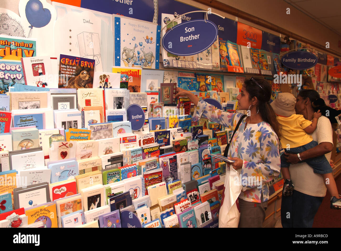 Customers Shopping For Greetings Cards In Card Shop Hounslow Stock