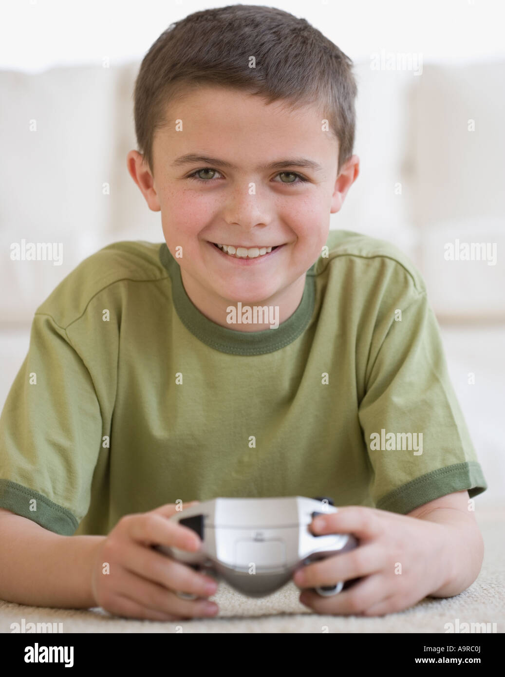 Boy holding video game controller - Stock Image