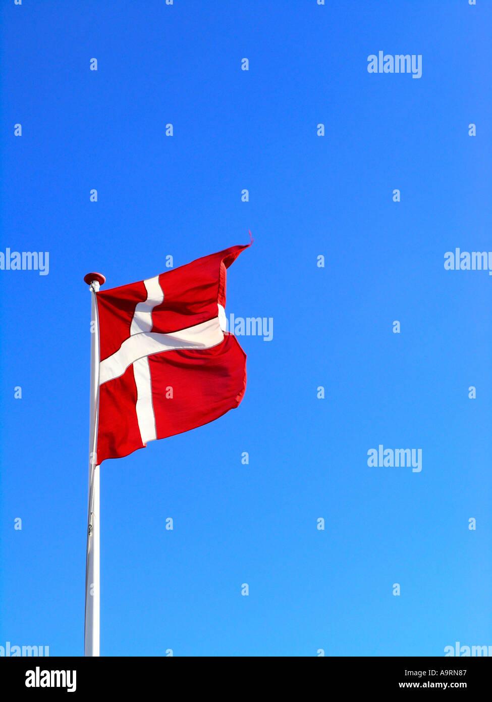 The danish flag Dannebrog waving in the wind - Stock Image