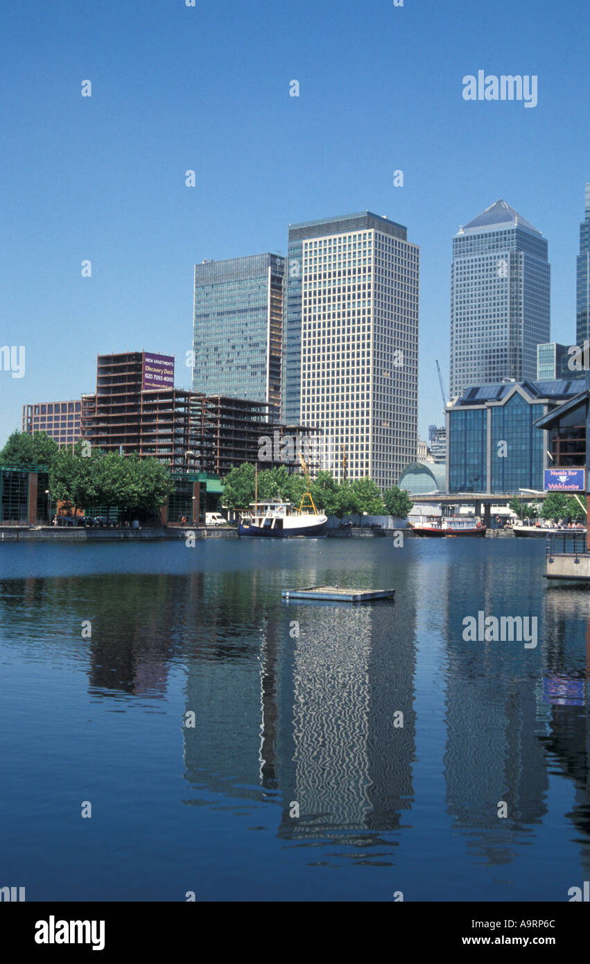 Canary Wharf buildings relfected in water - Stock Image