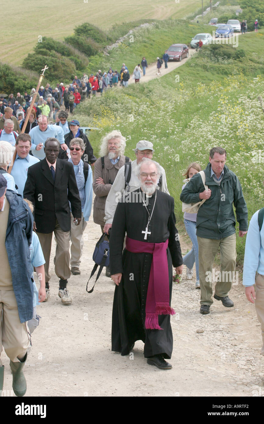 The Archbishop of Canterbury The Rt Revd Rowan Williams walking from the Chaple of St Aldhelm at St Aldhelm s head Dorset UK - Stock Image