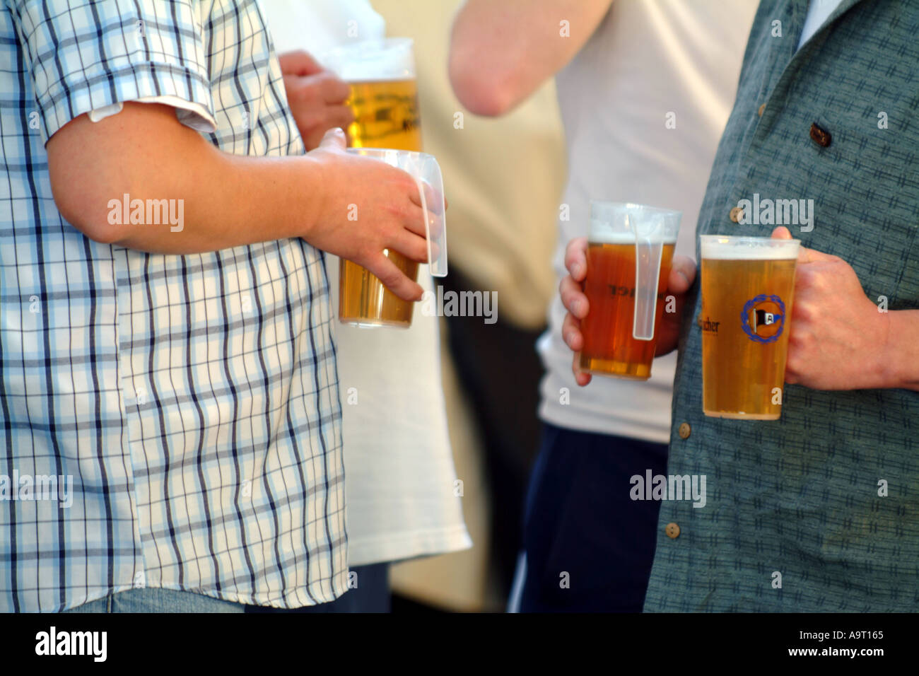 drinkers beer bellies men session lager - Stock Image