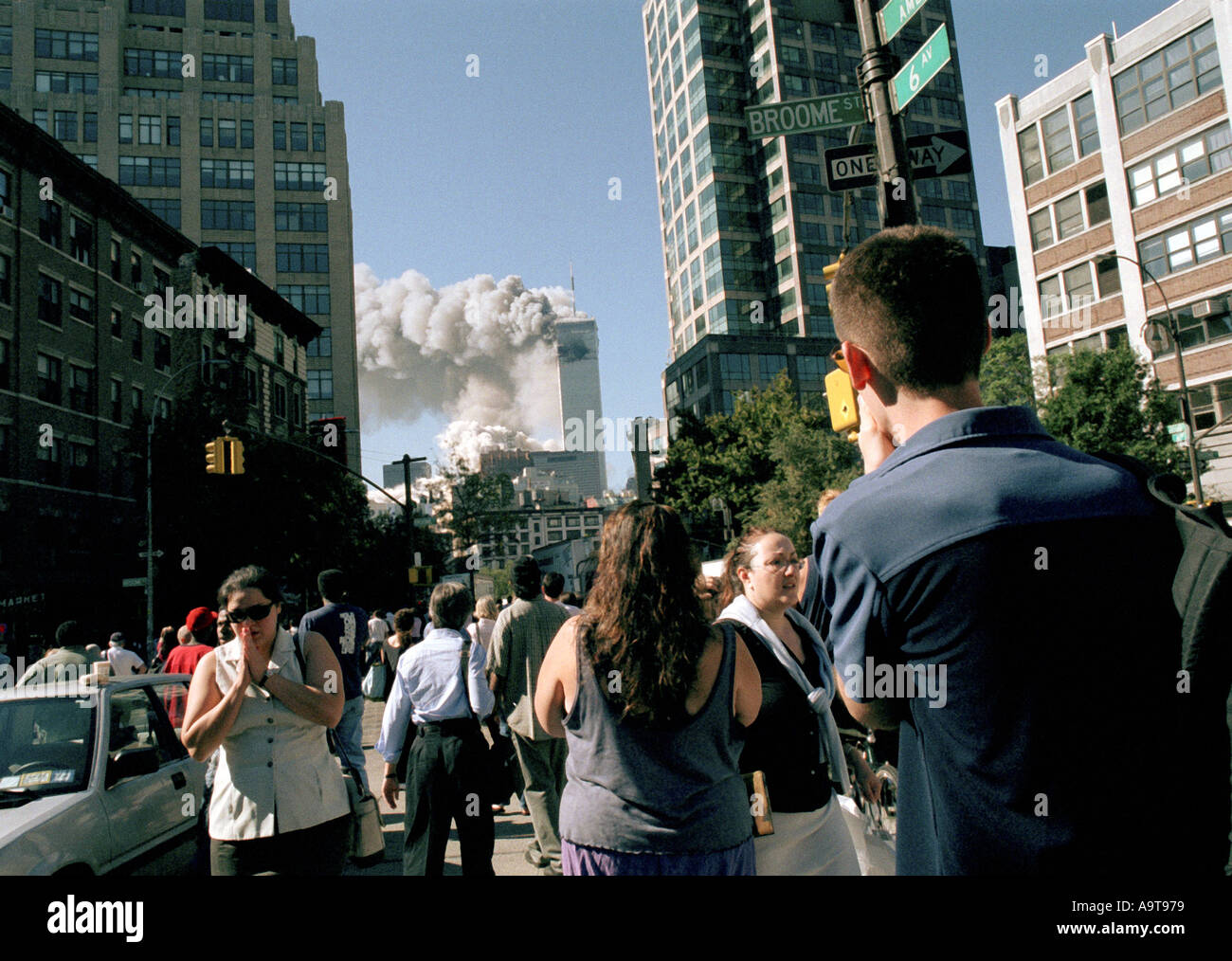 World Trade Center terrorist attack on September 11 2001 Workers watch from Sixth Ave in Soho as the towers collapse  - Stock Image